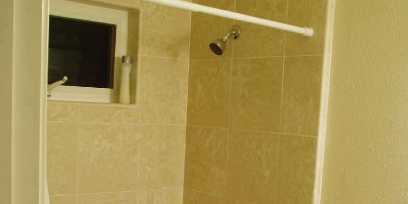 Designer Trick: Carry Your Shower Tile to the Ceiling